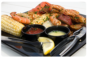 A Carolina classic, Lowcountry Boil featuring shrimp, snow crab,                  Andouille sausage, red potatoes and corn on the cob.