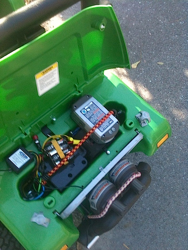 relocated Ryobi lithium battery under Jeep hood